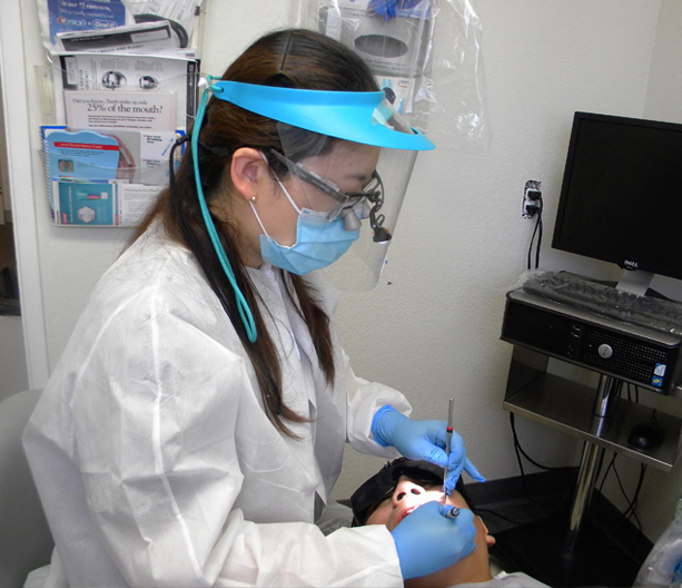 Dental volunteer working on a patient